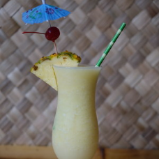 PIÑA COLADA — $11 - Creamy coconut, fresh pineapple and delightful rum blended to perfection.
