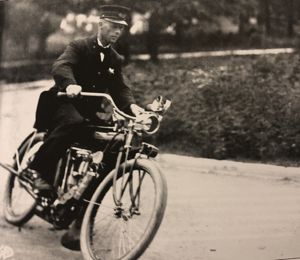 Police Chief John Coutre on a motorized bicycle during his tenure from 1909 to 1912 -