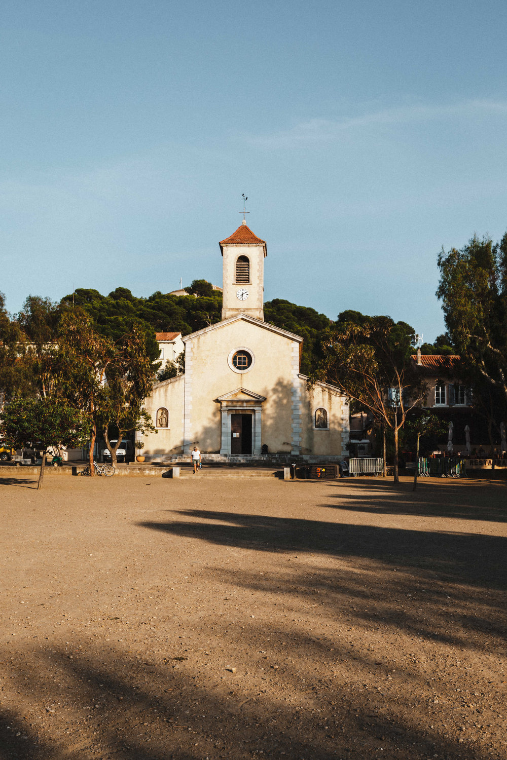 7 | Church of Porquerolles - Facing the square, the church is located in the Center of the village. With restaurants and shops all around. This is by far my favourite church and I always capture it while visiting the island. South of France, September 2018.