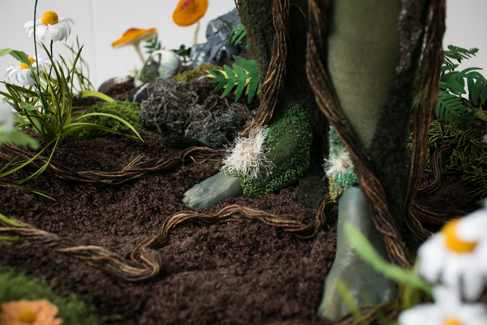 3D printed feet with hand embroidered moss patches and wool yarn roots.