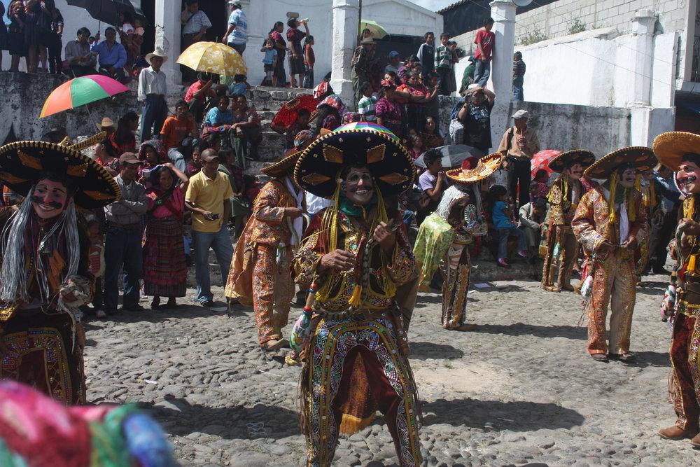 K'iche' Maya snake dancers in  El Baile de los Mexicanos , Day of the Dead, 2010 at Chichicastenango, Quiché Department, Guatemala.