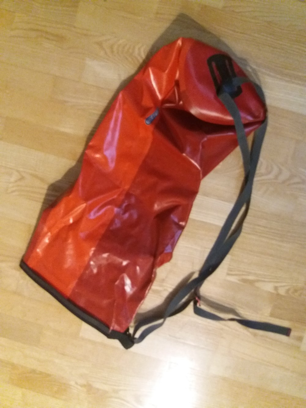 This bigger one is 20 liters, i think. you can example take it with you on a swim, stuff on the pack and the pack on the back. All stays dry. and this goes on the small space when folding.