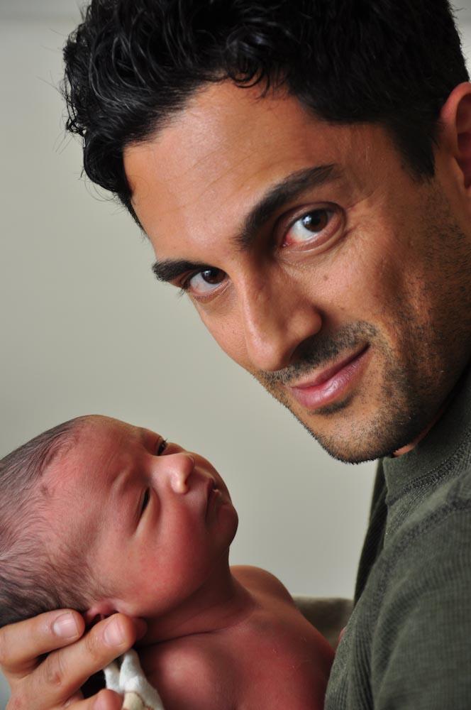 Newborn + dad looking at camera.jpg