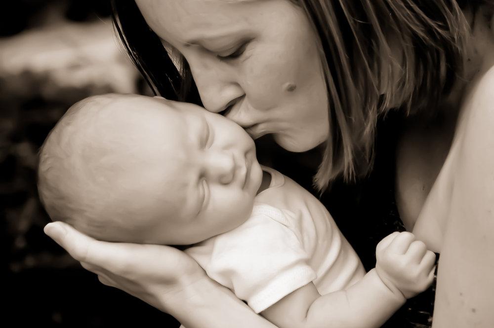 Mama kissing baby.jpg