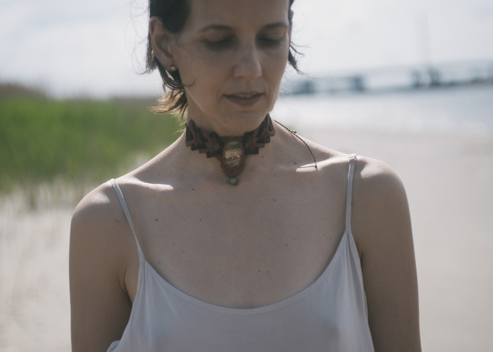 A macrame choker, find similar ones in the etsy stores I linked to