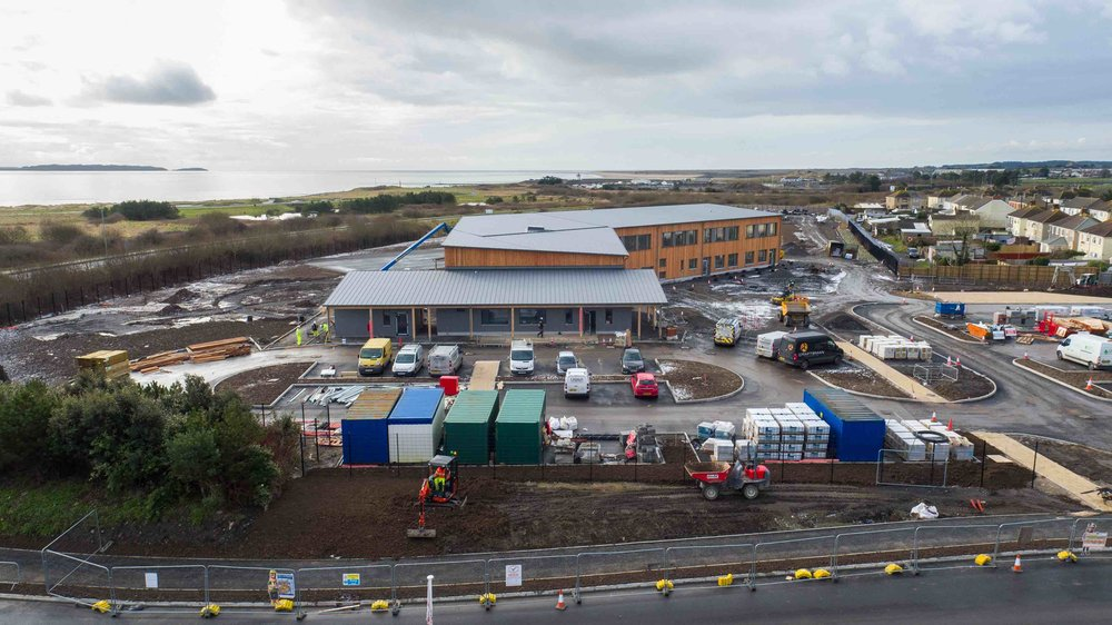 A school with a view - Almost completed, Ysgol Parc y Tywyn is situated on the former site of Carmarthen Bay Powerstation, a brownfield site, which runs alongside the Millennium Coastal Path, boasting beautiful sea views across the Loughor Estuary.