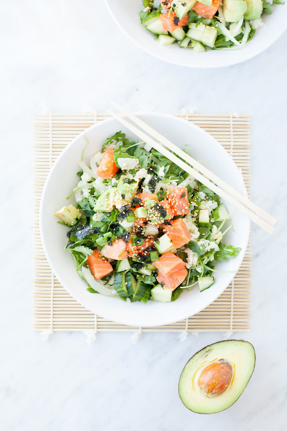 EASY SALMON POKE BOWLS   A quick healthy weeknight meal full of flavor - like sushi in a bowl! Sushi-grade salmon mixed with baby arugula and quinoa. Topped with avocado, sesame seeds, and roasted nori. Dairy-free and gluten-free.   LOVELEAF CO. #weeknightmeal #sushi #poke #pokebowl #healthydinner #easyrecipe #salmon #avocado #dinnerrecipe