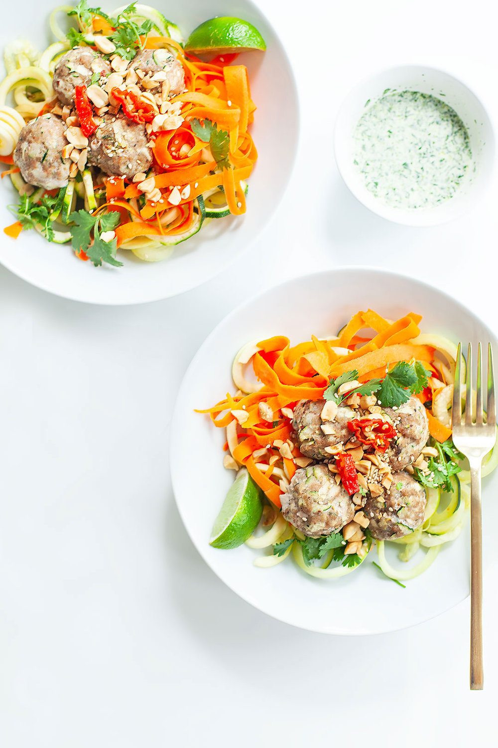 BÁNH MÌ BOWLS WITH ZUCCHINI NOODLES | Topped with baked turkey zucchini meatballs and cilantro pesto dressing. A healthy, easy, gluten-free, and paleo meal prep recipe. | LOVELEAF CO. NUTRITION #banhmi #salad #bowl #zucchininoodles #zoodles #glutenfree #paleo #grainfree #dinner #lunch #mealprep