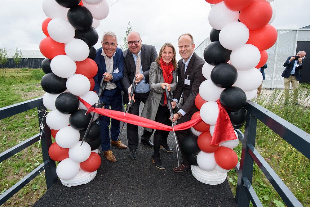 Pictured: Bridge official opening by FiberCore Europe CEO Jan Kroon,Jeanet van Antwerpen of SADC, alderman John Nederstigt of the Municipality of Haarlemmermeer and Joris Smits of Royal Haskoning