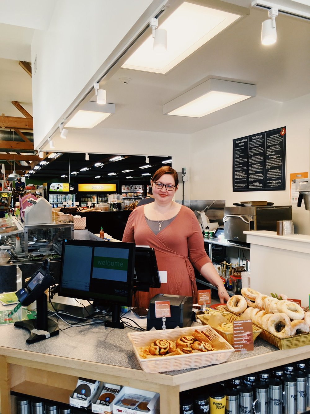 Staff and Board member Yitz mans our new Deli register