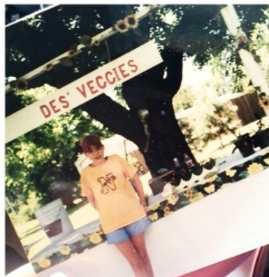 "Des Lynch, Summer of 2000, at age 12 stands in front of the original ""Des' Veggies Stand"""