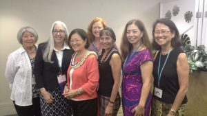 Commissioners with the Hawaii State Commission on the Status of Women pose for a photo with Senator Mazie Hirono.