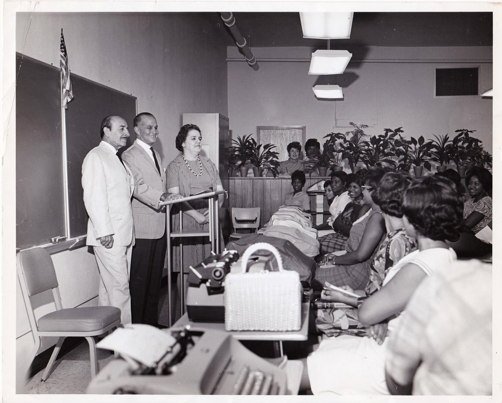Then-Mayor Victor Schiro, left, visits the Adult Education Center in 1968. Local lawyer and banker James J. Coleman, center. Dr. Alice Geoffray, right.