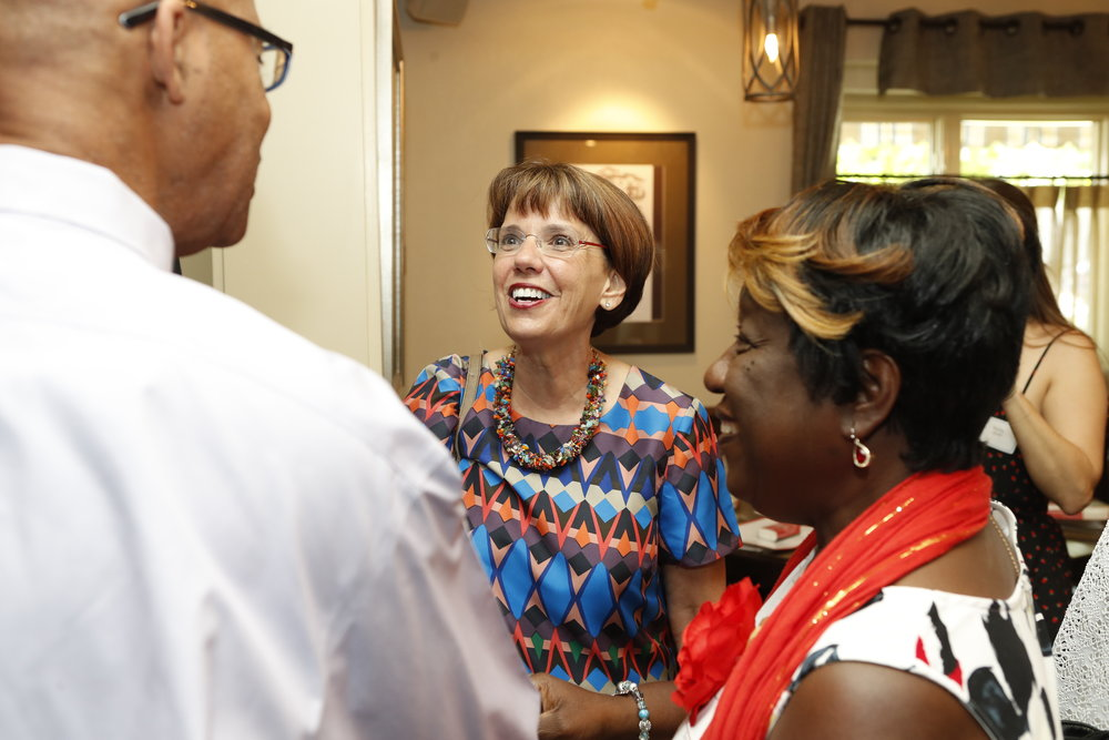 Sandra Owens Cook (right) with her husband, Darryl Cook (left), talking with Jeanne Geoffray (center) at the AEC 2018 Reunion