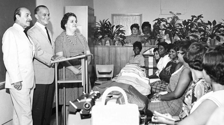 New Orleans Mayor Vic Schiro, left, businessman James Coleman Sr. and Alice Geoffray address students at theAdult Education Center in 1965. The school lasted just seven years but changed lives forever.  Photo | COURTESY JEANNE GEOFFRAY