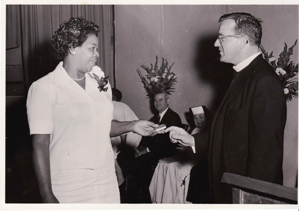 '66 Dolores Thornton and Father TImothy Gibbons