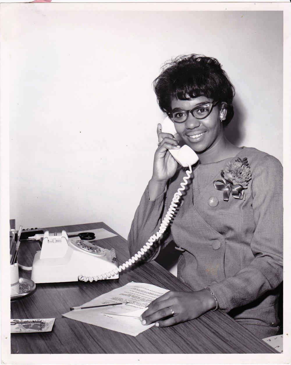'67 Carol Williams talking to Jeanne Ansel, secretary to Lowe's Hotel President, NYC