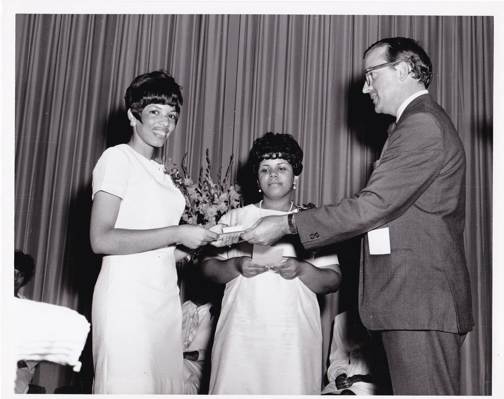 '69 Sylvia Cheatham (Left) and Father Timothy Gibbons (Right)