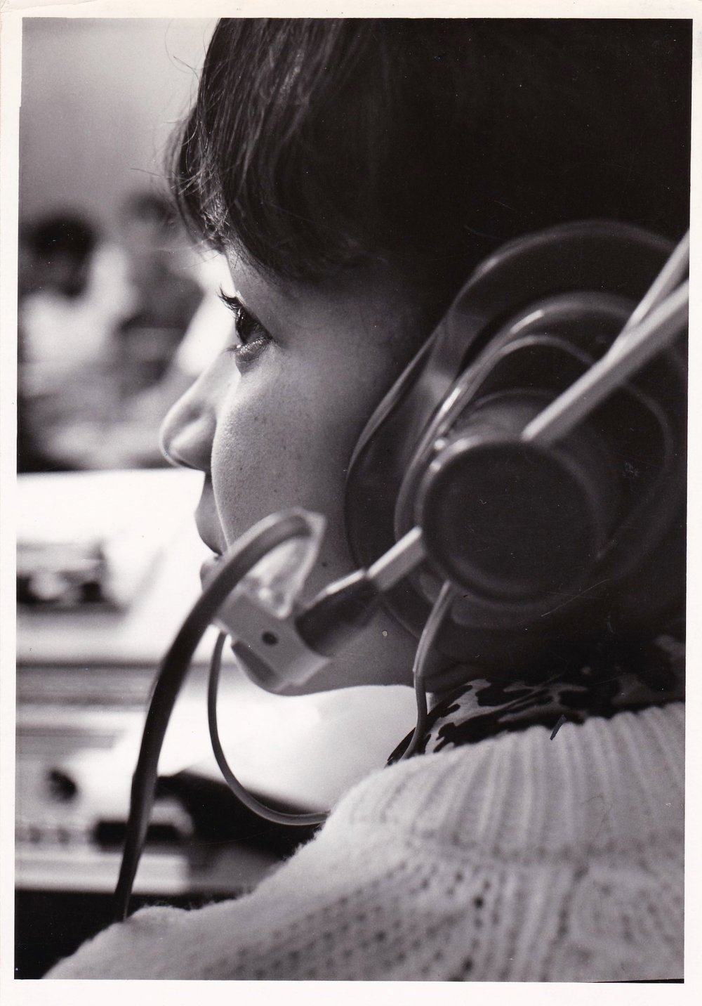 '66 Lorraine Theophile in Speech Class lab hearing and practicing the sounds of business speech.