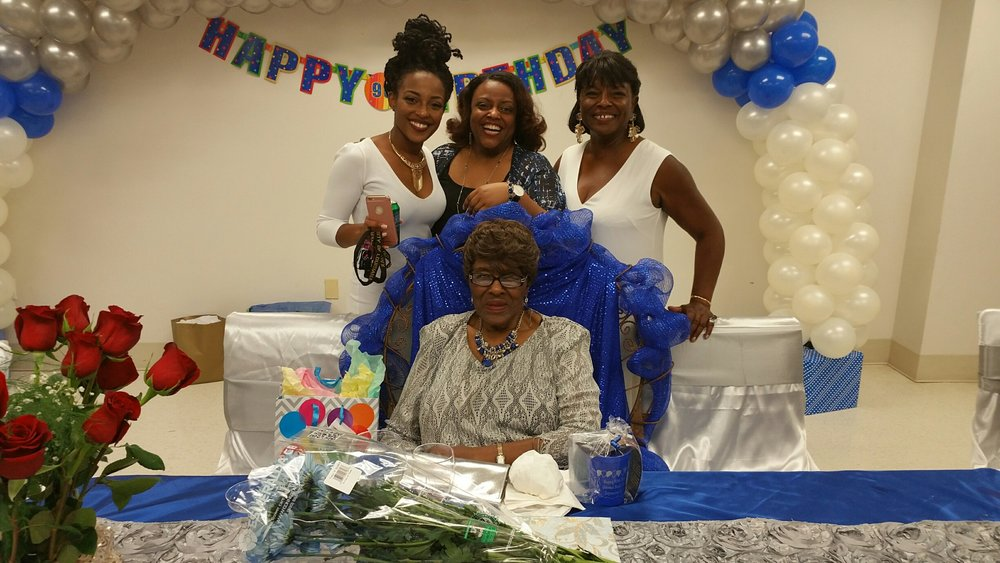 Four generations together celebrating the 90th birthday of Mrs. Gennive Bazile Treaudo (seated). Standing L-R: Bria Rene Wroten, Deana Catrice Bell, Carolyn Treaudo Bell.