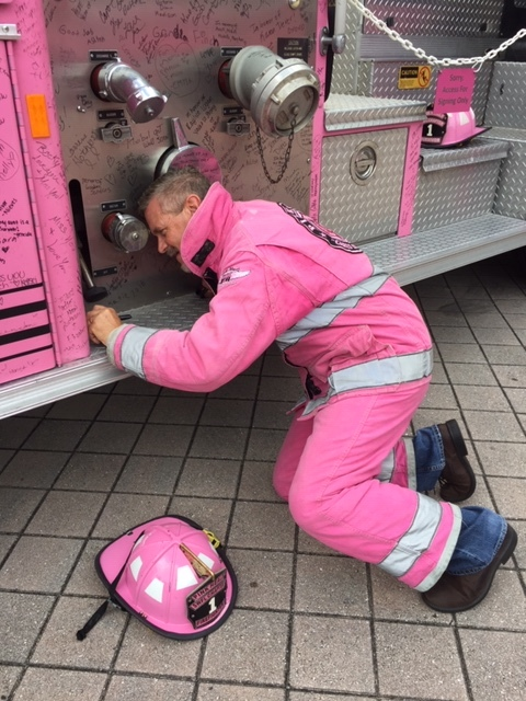 2 Time Prostate Cancer Survivor Chaplain Goodman signing Pink Heals fire truck