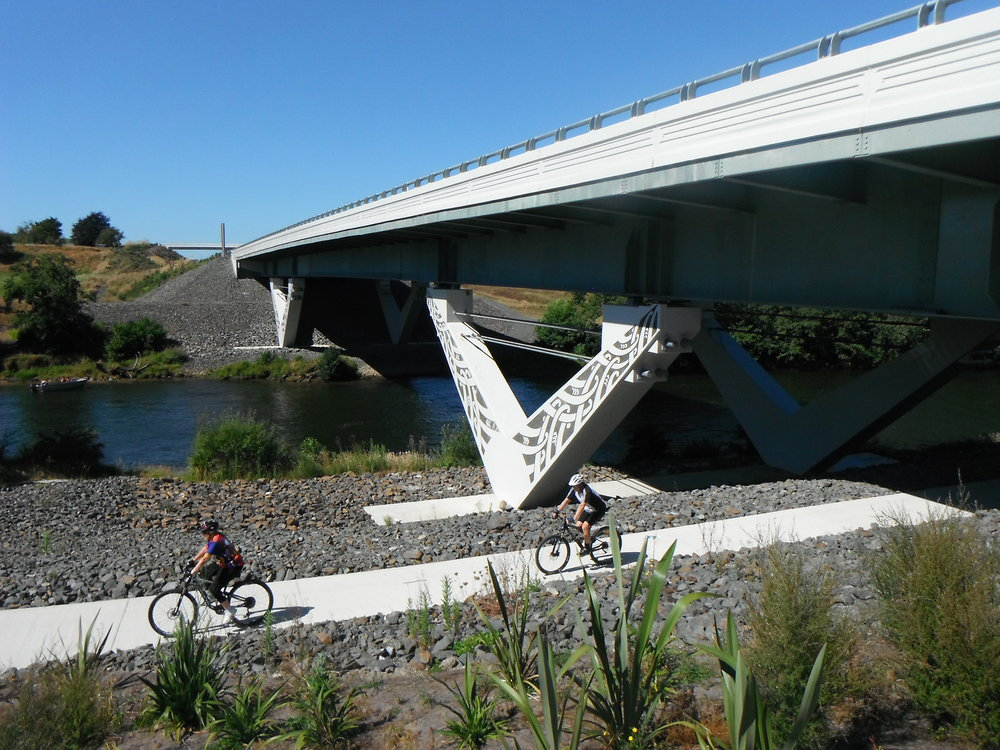 Waikato River bridge with cyclists.JPG