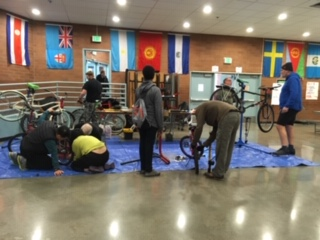 Image is of B4HPDX volunteers helping to fix bikes at the 3rd Winter Fix-It-Fair. Picture is courtesy of Fix-It-Fair organizer Lauren from Repair PDX.
