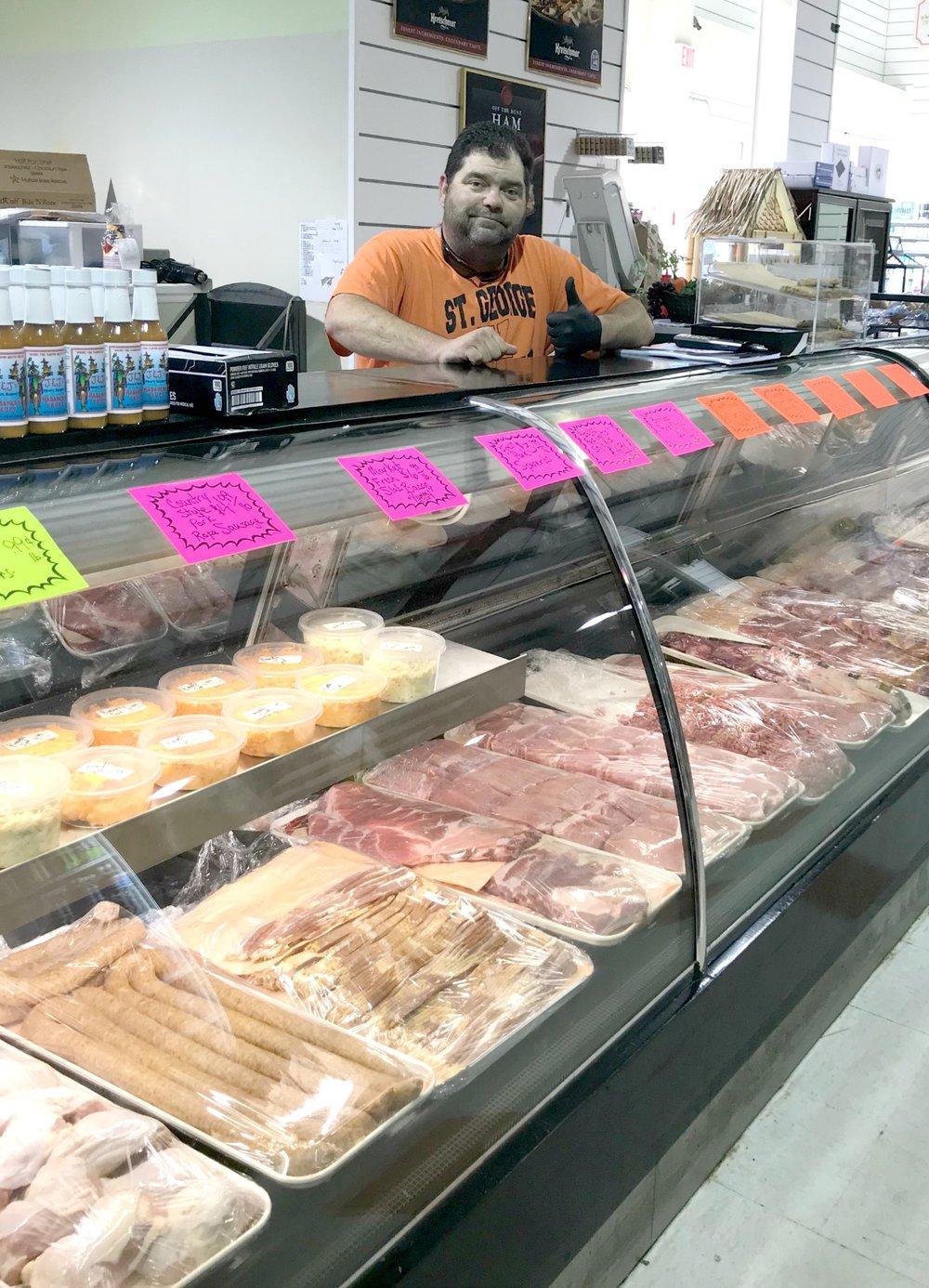 Richard at meat counter.jpg