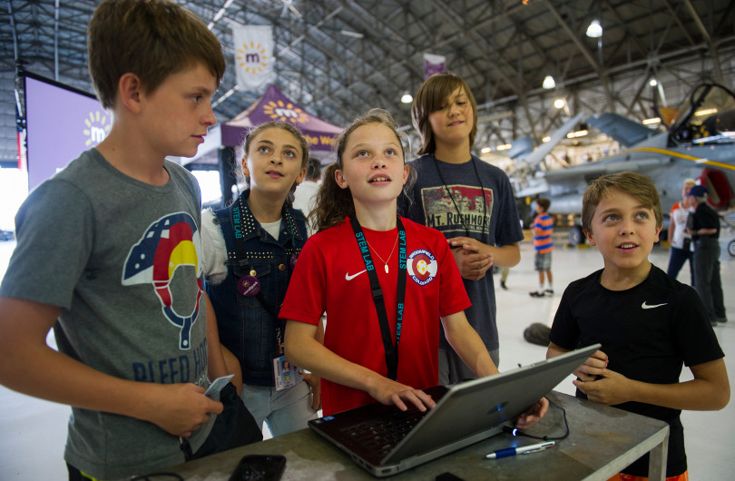 STEM Lab School students Josh Gifford, 13, from left, Jennah Saleh, 11, Sydney Webster, 12, Riley Glass, 12, and Owen Sailer, 11, fly a DJI Tello drone during an open house to launch a first-ever Drone Project Friday, Sept. 7, 2018 at Wings Over the Rockies Air & Space Museum.
