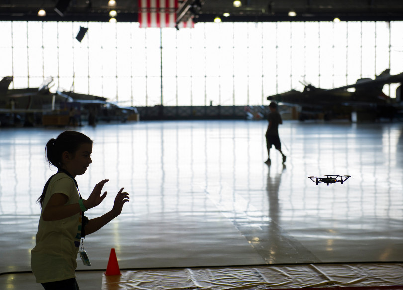 STEM Lab School seventh grade student Nadia Rebholtz-Herrera, 12, helps direct a DJI Tello drone to land during an open house to launch a first-ever Drone Project Friday, Sept. 7, 2018 at Wings Over the Rockies Air & Space Museum.