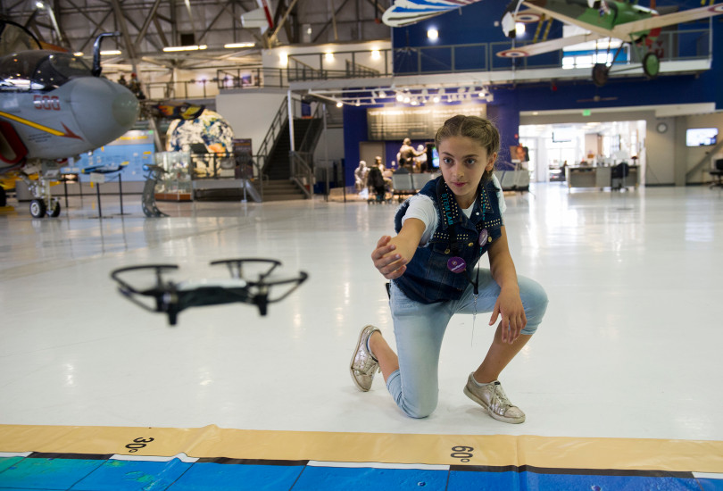 STEM Lab School sixth grade student Jennah Saleh, 11, helps direct a DJI Tello drone to land during an open house to launch a first-ever Drone Project Friday, Sept. 7, 2018 at Wings Over the Rockies Air & Space Museum.