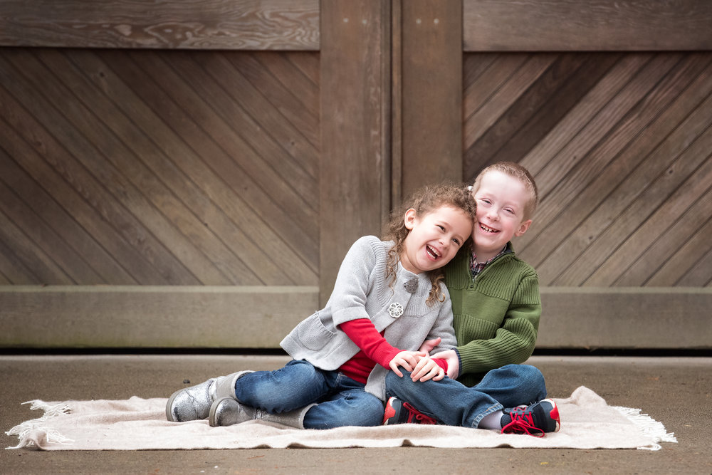 Brother and Sister Laughing at Barn Door