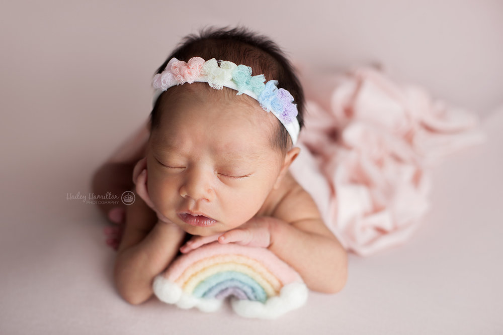 Baby girl photography with rainbow prop