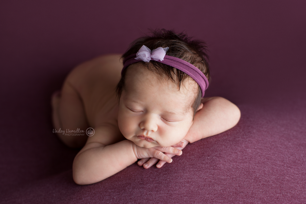 Perfectly posed newborn girl photography