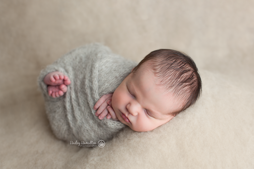 Simple wrapped newborn boy