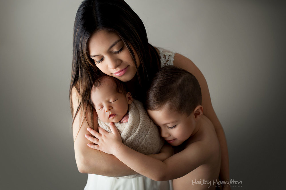 Newborn Family Portrait with Mom and Brother