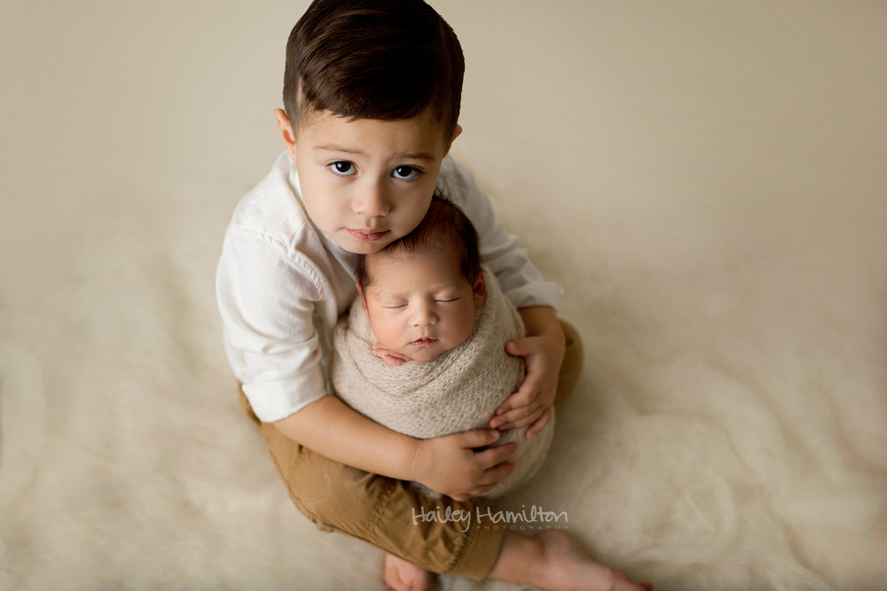 Newborn Boy with Happy Older Brother