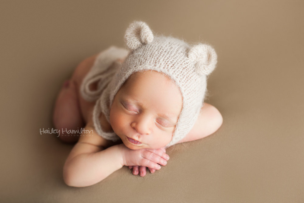 Newborn Boy Wearing Bear Bonnet