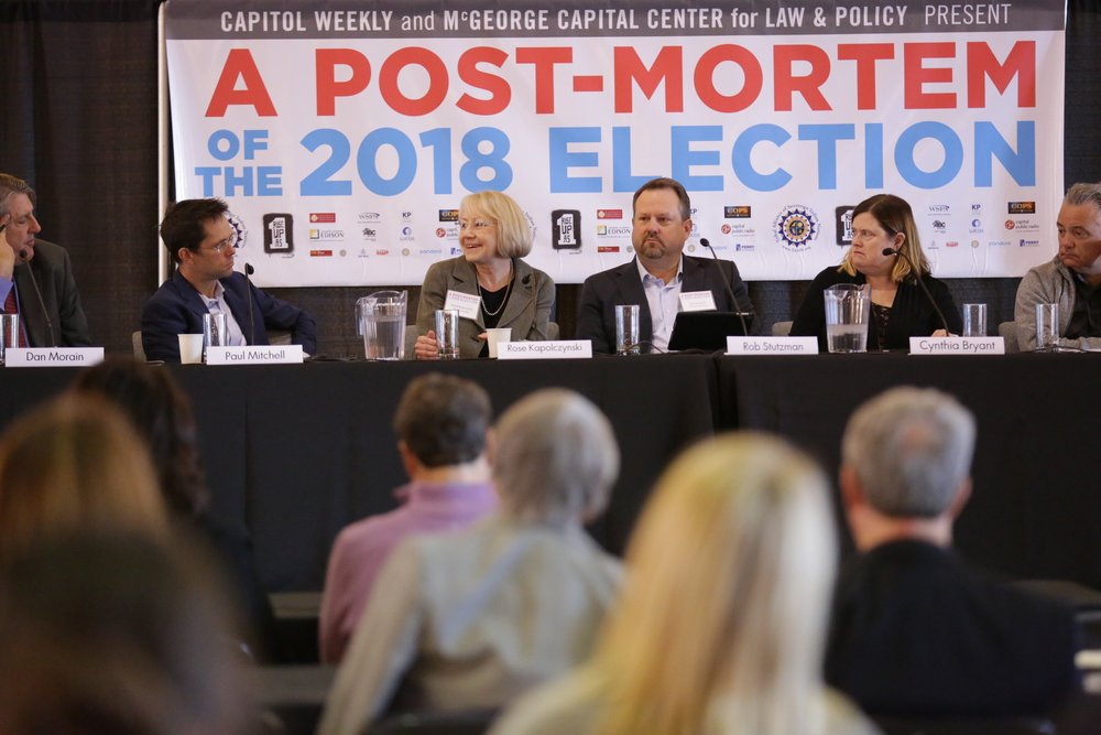 "Dan Morain moderates panelists Paul Mitchell, Rose Kapolczynski, Rob Stutzman, Cynthia Bryant, Parke Skelton, Katie Merrill in a conversation on the hyped ""Blue Wave.""  Photo by Scott Duncan, courtesy of Capitol Weekly."