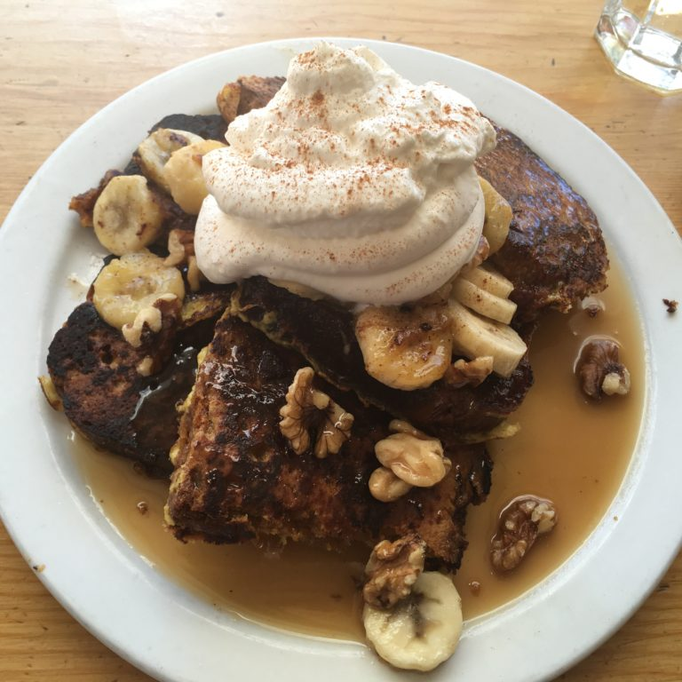 Pumpkin bread french toast topped with bananas, walnuts and rum caramel sauce. Photo by Rachael Worthington