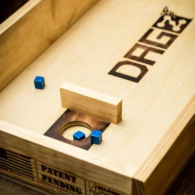 What is DAGZ? - DAGZ is an entertaining and competitive recreational dice game that emulates the premise of larger indoor and outdoor games like bags/corn hole, horseshoes and washers...minus the limitations of size and weather. The DAGZ game board offers the challenging elements of navigating barriers with dice through a ricochet or by bouncing off the surface or wall to reach the scoring area. The DAGZ game offers additional benefits of proficiency for one's ability to develop methods and techniques for throwing the dice, enticing those who enjoy games of entertainment, competition and aptitude.