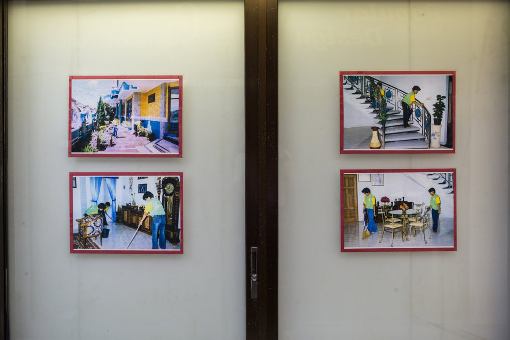 May 10, 2014 - SIngapore. Images advertising the work of migrant workers on the wall of a maid agency in Bukit Timah shopping plaza. © Nicolas Axelrod / Ruom