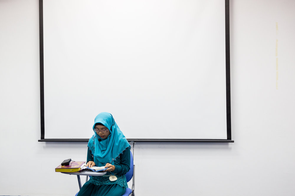 June 08, 2014 - Singapore. Anandha recites the Koran during a contest organised by local Humanitarian organisations. © Nicolas Axelrod / Ruom