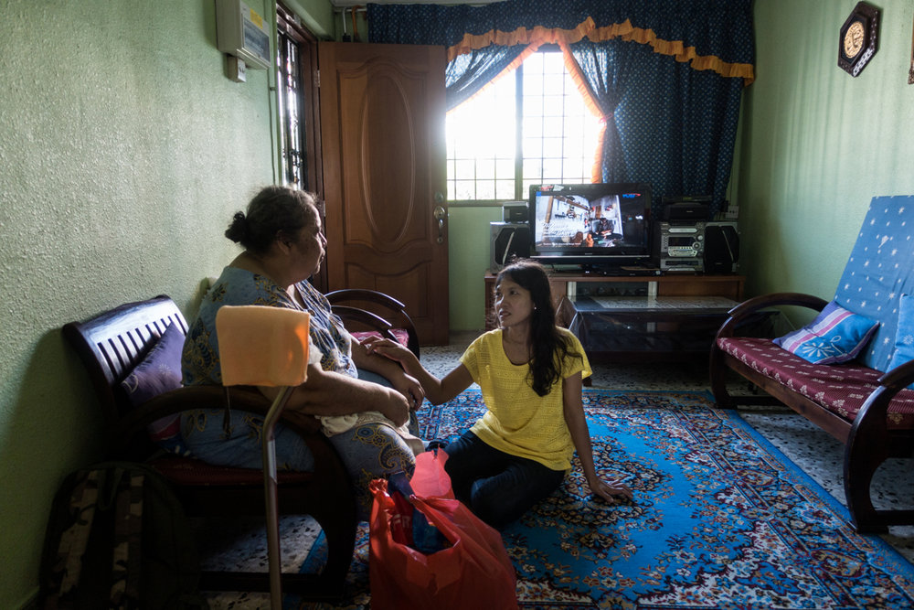 Jan 14, 2017 - Singapore. Tutik visits her previous employer in her home. Tutik stopped working for the family to return to her home in Indonesia. A few months later she decided to return to Singapore and work for a new employer. © Nicolas Axelrod / Ruom