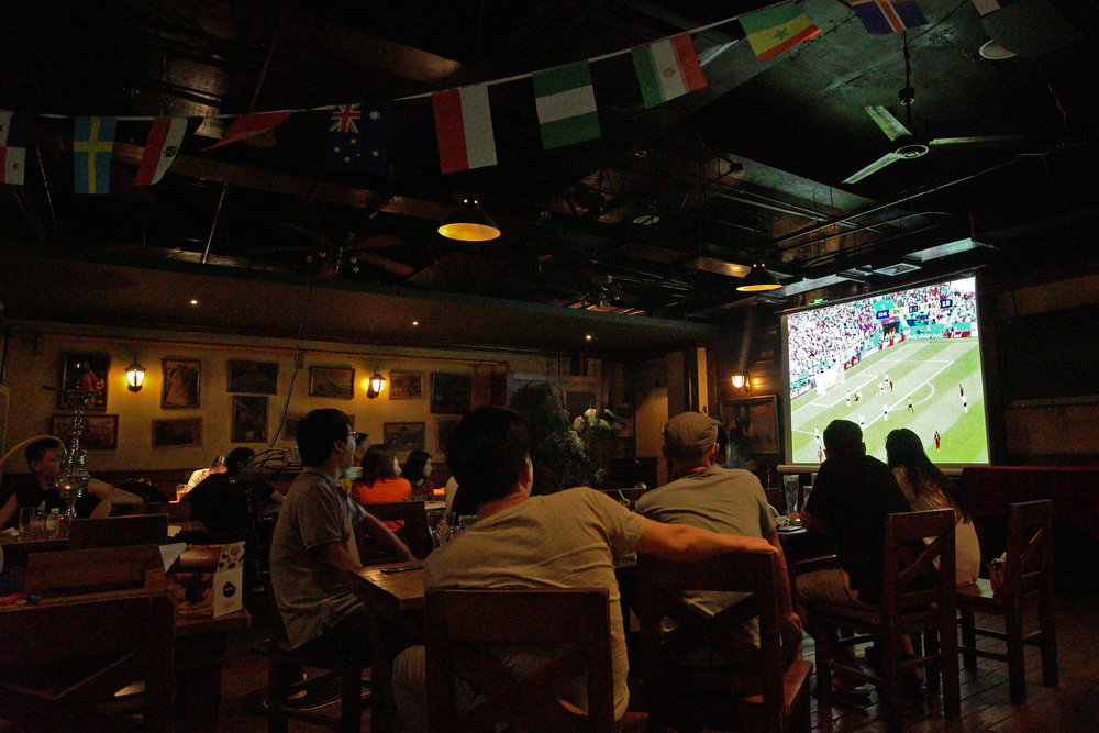 Chinese fans watch a World Cup match from a bar in Beijing.jpg