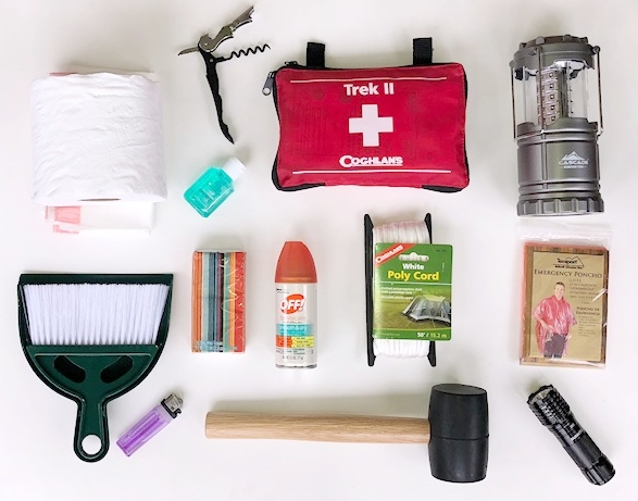 """Contents of our """"Essentials Box *Can vary based on availability. Always includes Maui Revealed Book, First Aid Kit, Flashlight, Lantern, bug spray, hammer and lighter."""