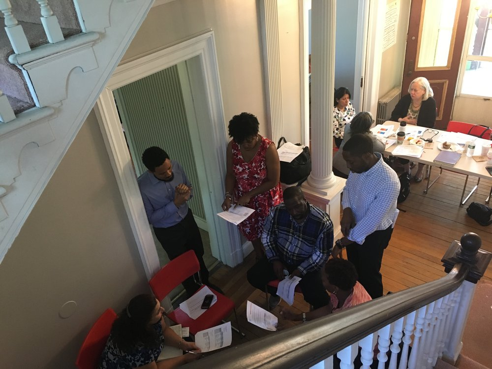 Members of the Steering Committee in Staten Island in discussion during a recent Steering Committee meeting in a rather unlikely location – a vacant house on church property.
