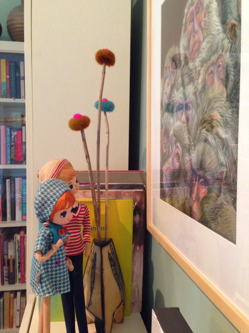Vintage dolls in our dining room admiring Cora Waterhouse's 'Henrietta's Millions'.