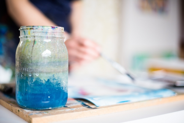 Beautiful blue paint water in a glass jar.jpeg