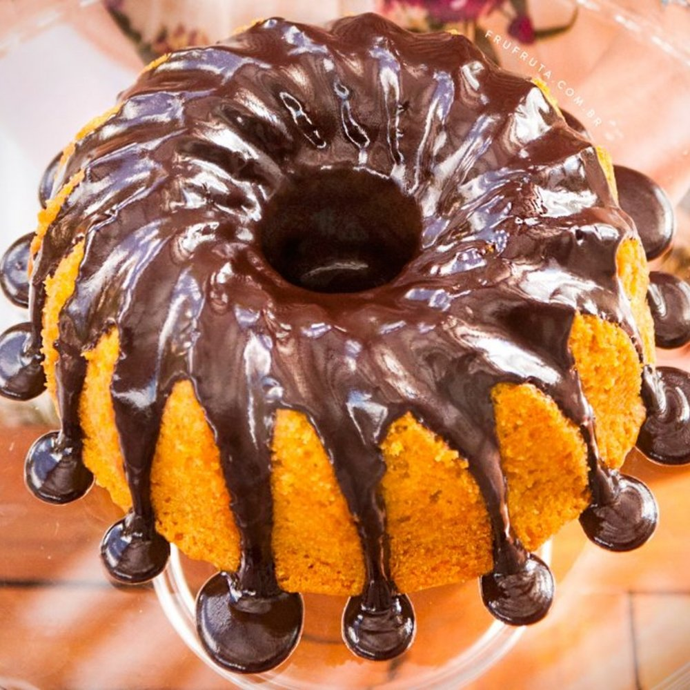 Brazilian Carrot Cake - Our version of carrot cake topped with a thick chocolate glazed sauce.